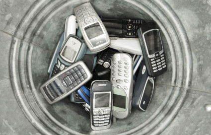 disused old mobile phones in dustbin